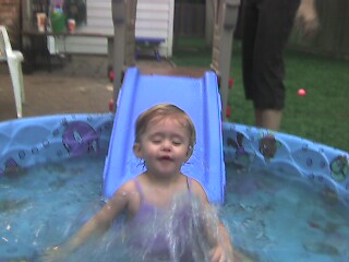 Kiddie slide plus kiddie pool equals kiddie fun